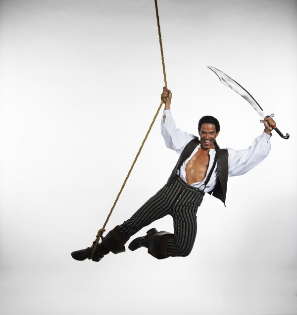 Brandon O'Neill plays the Pirate King in The Pirates of Penzance at The 5th Avenue Theatre. Credit Mark Kitaoka