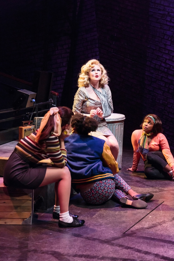 Audrey (Jessica Skerrit, center) and the trio (l-r) Crystal (Naomi Morgan), Chiffon (Alexandria Henderson), and Ronette (Nicole Rashida Prothro) in Little Shop of Horrors, a co-production of ACT and The 5th Avenue Theatre.   Credit: Tracy Martin