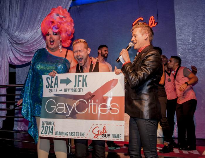 Mama Tits and Patrik Gallineaux present Stoli Guy Seattle winner Sean C. with his Big Gay Boarding Pass.  Photo: Tim Harmon